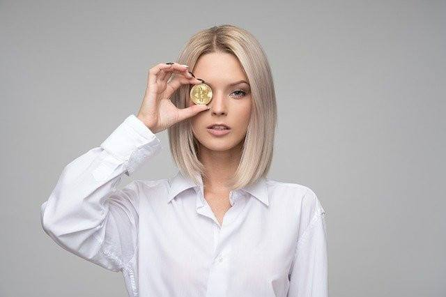 a woman with a coin in her eye