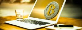 bitcoin on the laptop's screen